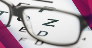 glasses sitting on an eye chart